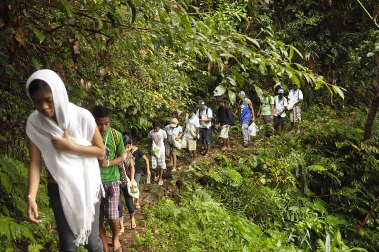 Volunteers hike the mountains of Malay, Aklan to plant trees